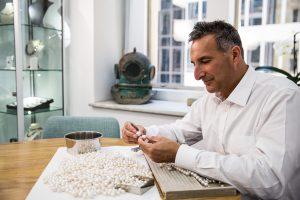 David sorting pearls