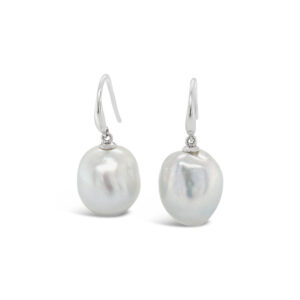 A pair of silver toned Australian South Sea Pearls, 13mm in size, baroque-drop shaped, grade 1, AAA luster. set on 9 carat white gold shepherd hooks.