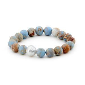 One 12-13 millimeter South Sea Circle Shape Cultured Pearl on an elastic bracelet with 10 millimeter round Denim Blue Aqua Terra Jasper, Matt Finish beads