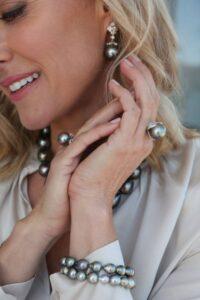 woman modellingblack pearl jewellery