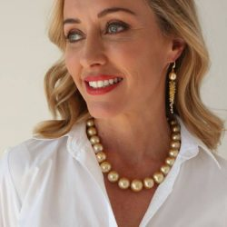 lady modelling a gold pearl necklace